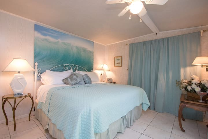 Delicious King bed awaiting for your dreams by the beach.
