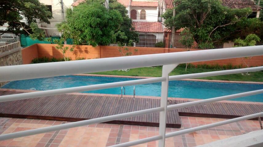 Piscina que veras al salir al balcón / View from the balcony overlooking the pool