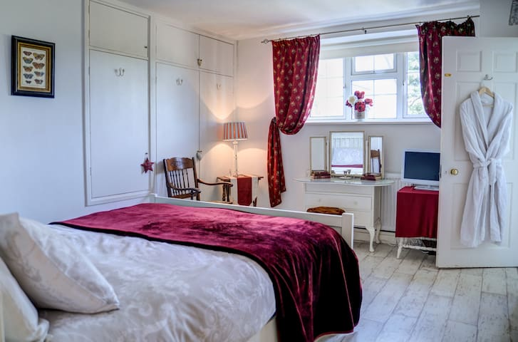 The Red bedroom is truly comfy with its queen size bed and stylish decor.
