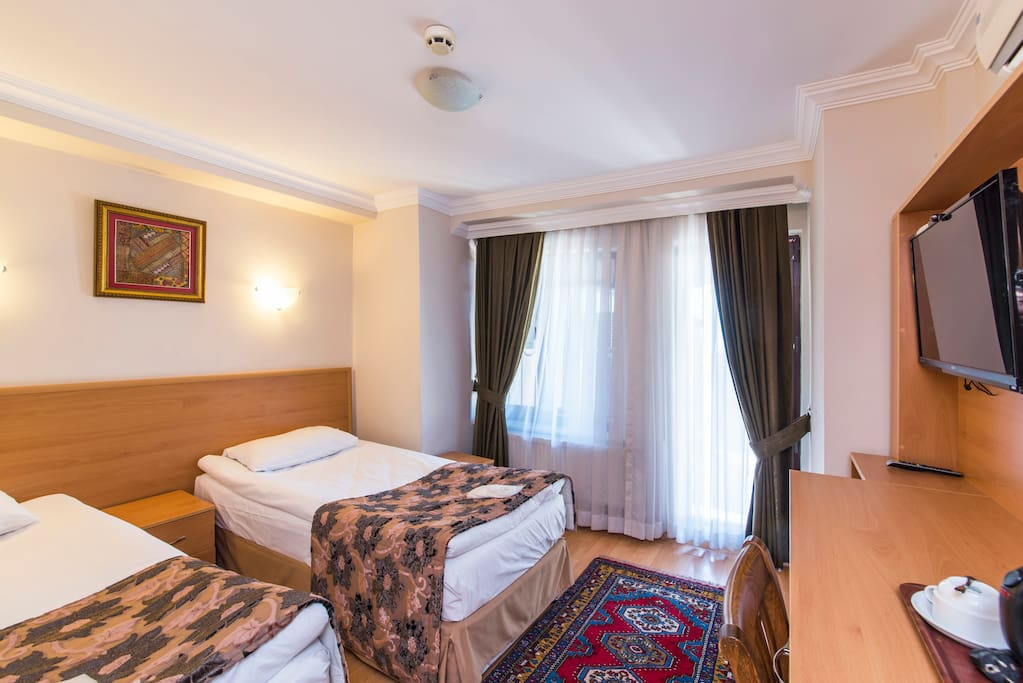 Clean, comfortable, modern room. Air-conditioned & Furnished with comfortable beds. French Bed & Twin Bed preferences...