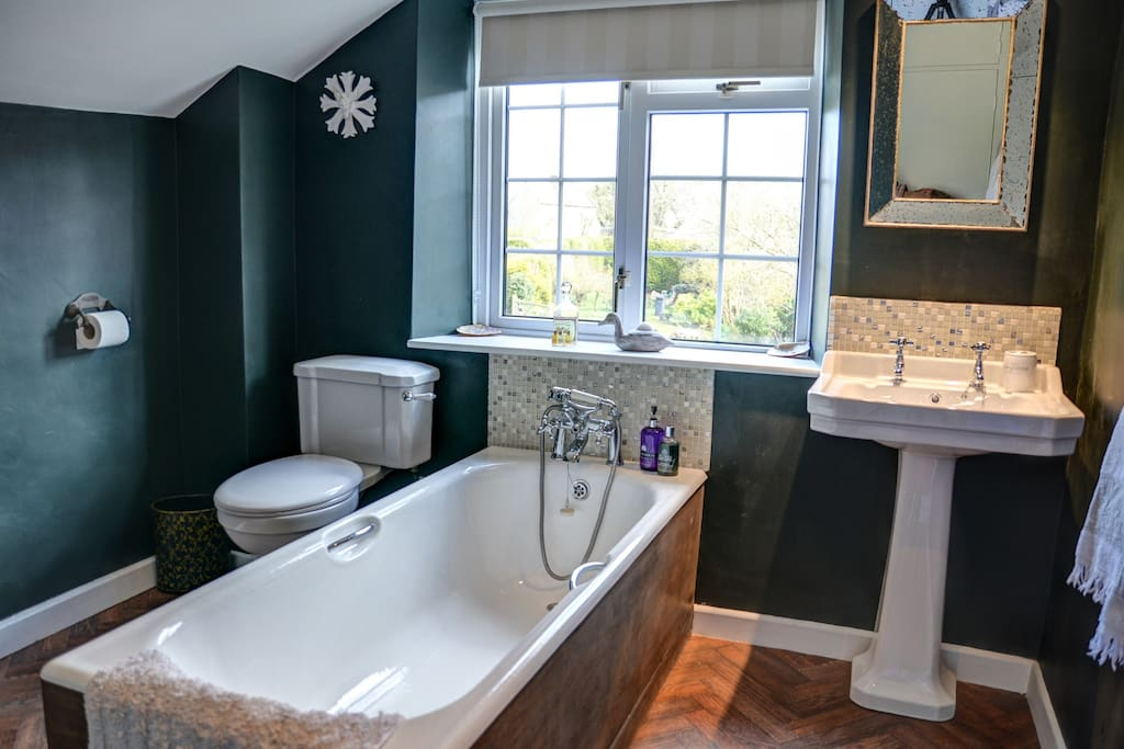 You can soak your cares away in the en suite bathroom overlooking the garden ........