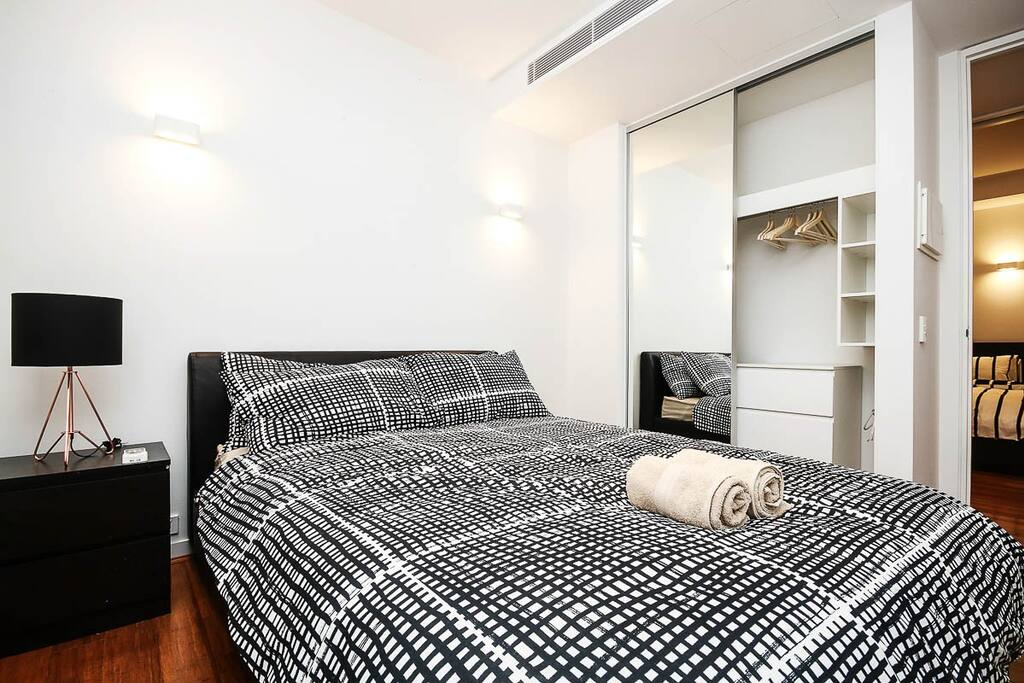 Master Bedroom - Comfortable bed, fluffy pillows and warm quilts to accompany your nights at the apartment.