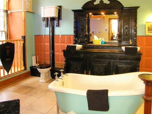 On suite with power shower and slipper bath