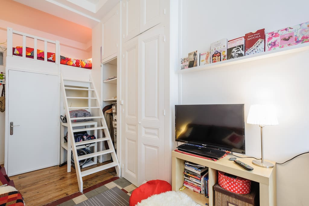 At this picture you can think that the sleeping room upstairs is pink - it's white in reality and the color comes from the lamp and red bed linen:)