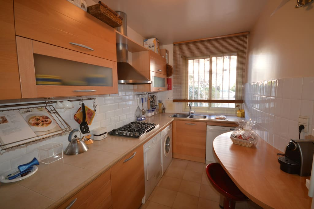Well equipped kitchen including : washing machine, dryer,  dishwasher, oven, microwave, nespresso machine etc...