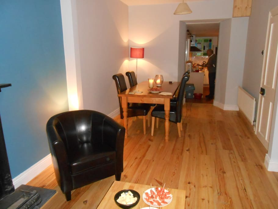 Dining Room opening to the living room and kitchen. Evening meals can be enjoyed