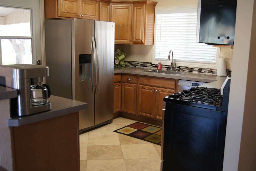 All new kitchen, Bosch and Kenmore Elite appliances, concrete countertops.