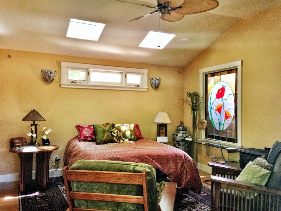 Skylights and stained glass create a lovely, light filled room
