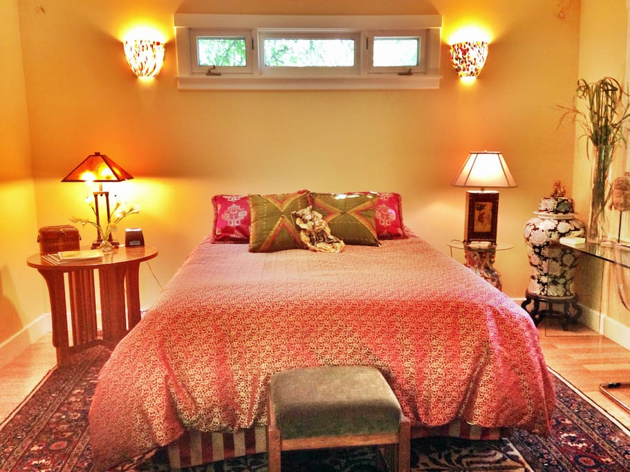 Queen sized bed with bedside tables and lights for reading and quality linens.