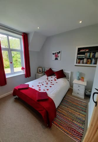 Beautiful master bedroom with king sized bed and ample storage.  The window overlooks the grounds of Highwood Farm with views stretching over the neighbouring fields.