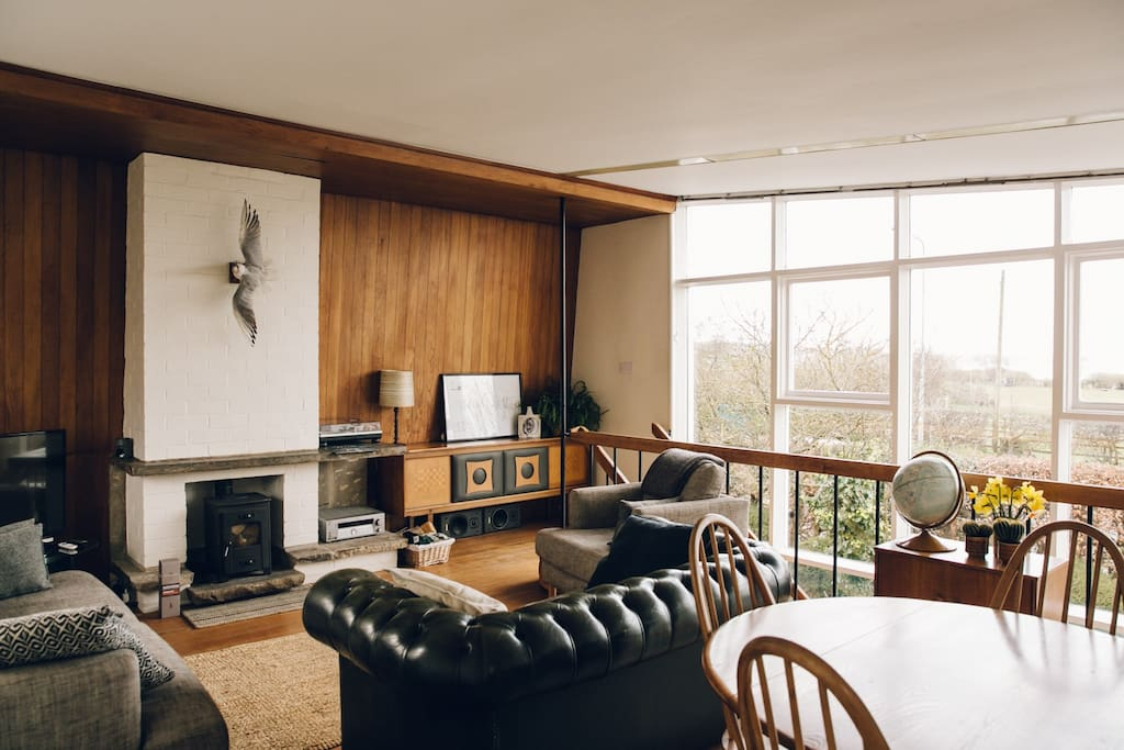 First floor lounge with sea views and log burner. Photo courtesy of India Hobson.
