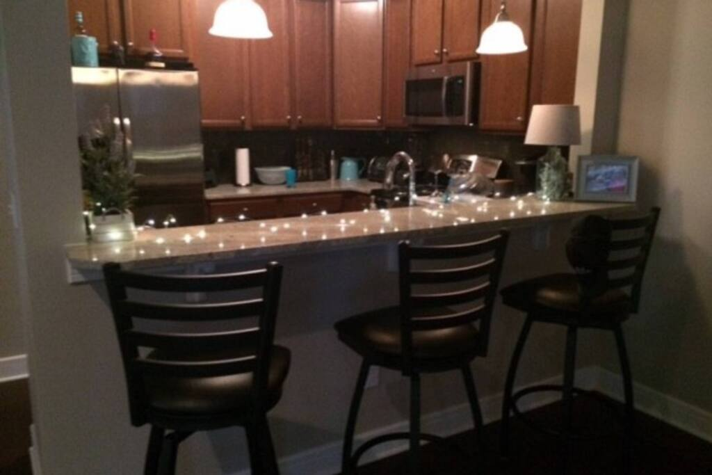 Granite countertops and stainless steel appliances.