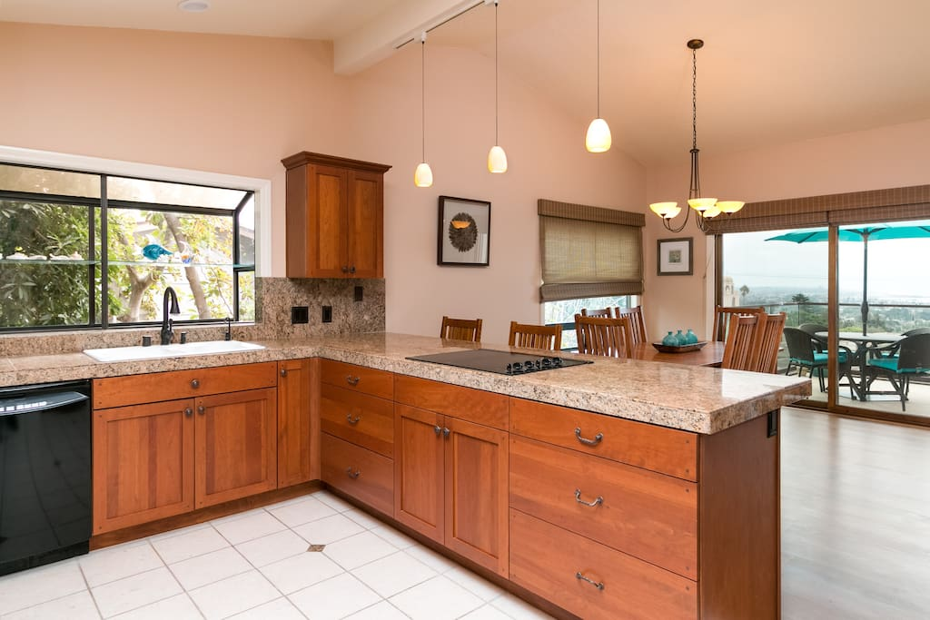 An open concept kitchen has lots of granite countertop space for keen chefs