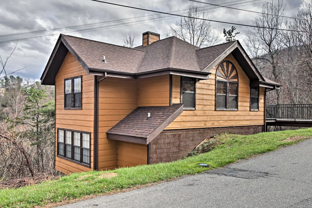 The home is situated on the side of a mountain with great Smoky Mountain views.