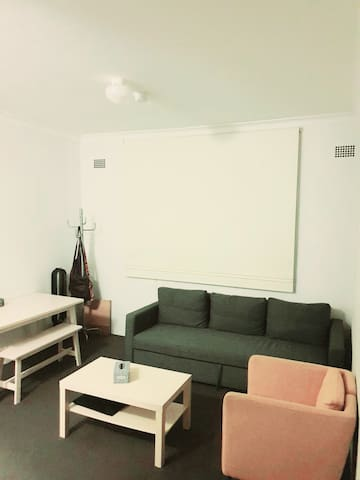 Comfortable sofa bed/ lounge space in Camperdown.