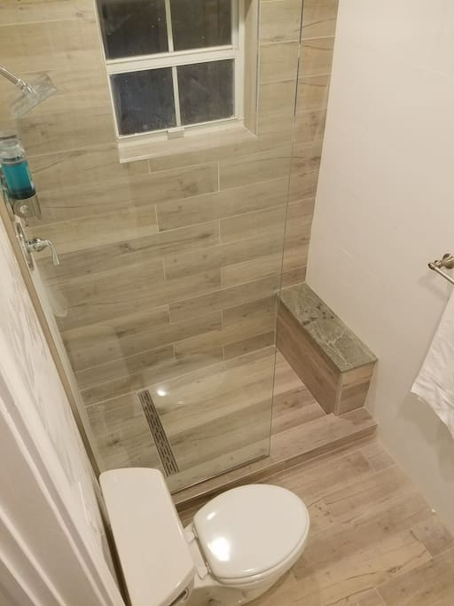 Custom, private, spacious porcelain, granite, & glass shower with body wash, creme rinse, & shampoo infused with sea algae extract & vitamin E. Plenty of fresh towels to complete the spa like amenities.