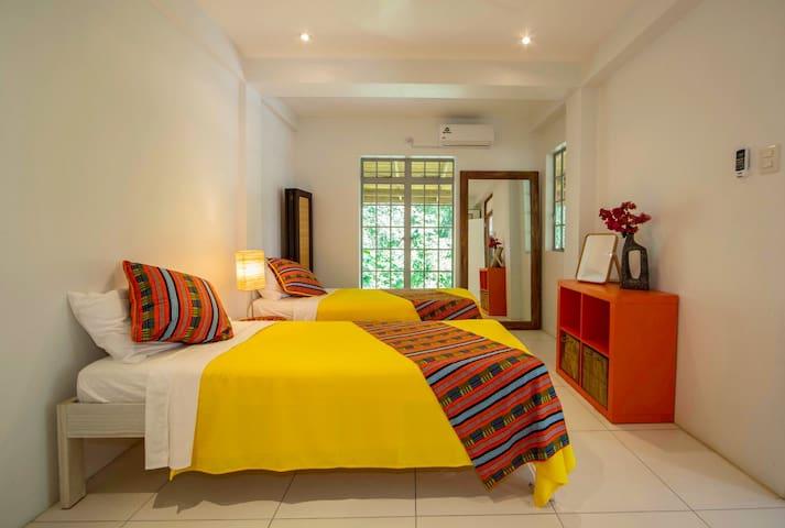 Twin bedroom with en-suite bathroom.