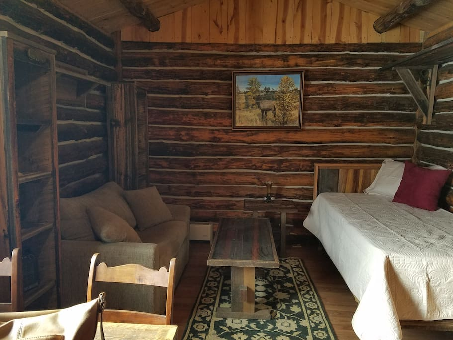 Cabin inside with single bed and single bed couch