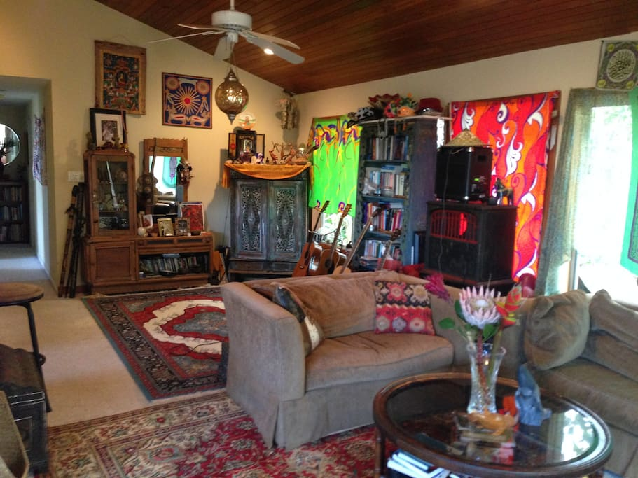 A comfortable living room with library and exotic art and collectables