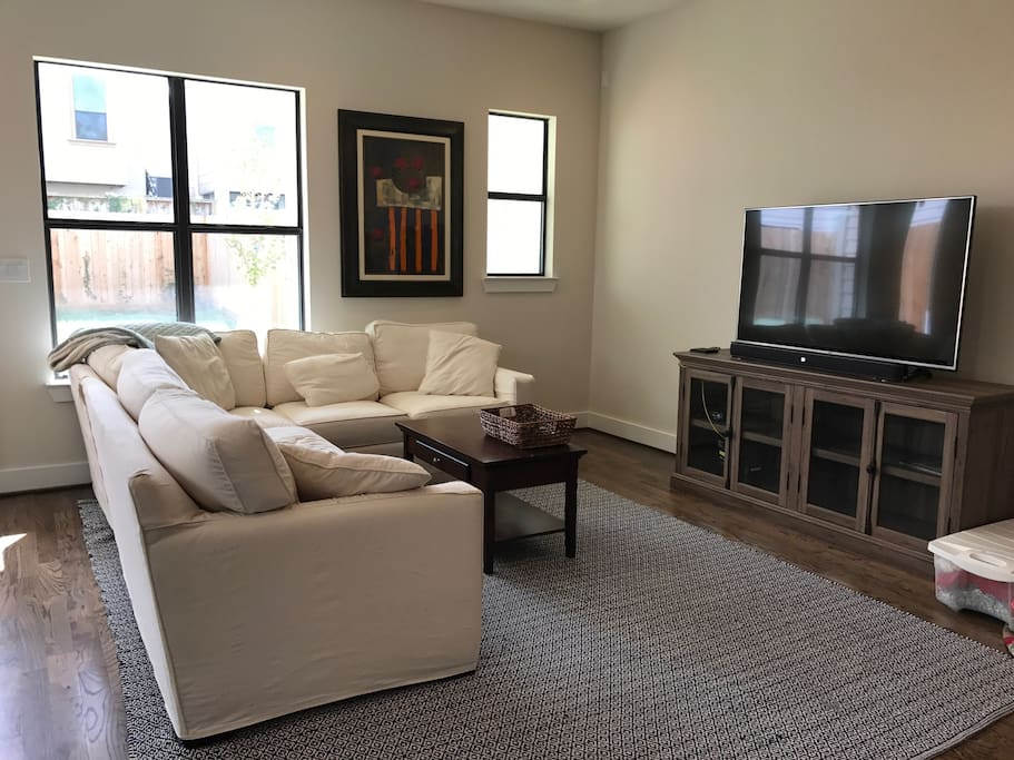 "Comfortable sectional and 55"" 4K TV in living room"