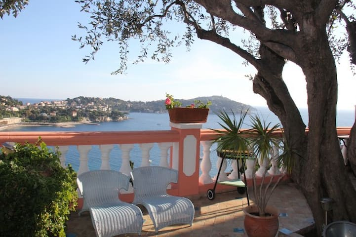 Your outside seating with incredible plants  flowers and view at your Little paradise apartment in Villa Escabelle Villefranche sur Mer France