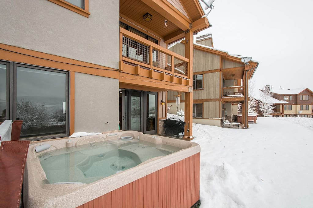 The large Jacuzzi hot tub has comfortable seating for seven (7) people and offers great views of Jordanelle Reservoir.