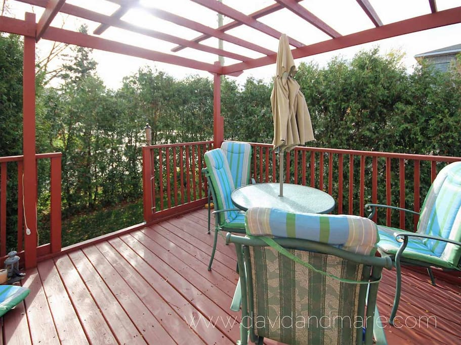 Outside Deck with table and chairs off of Kitchen.