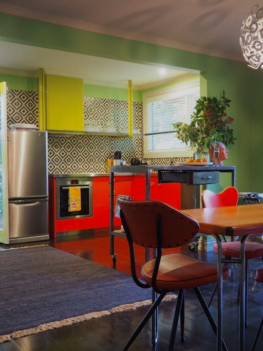 Fully equipped kitchen with cooking facilities and large outdoor dining deck
