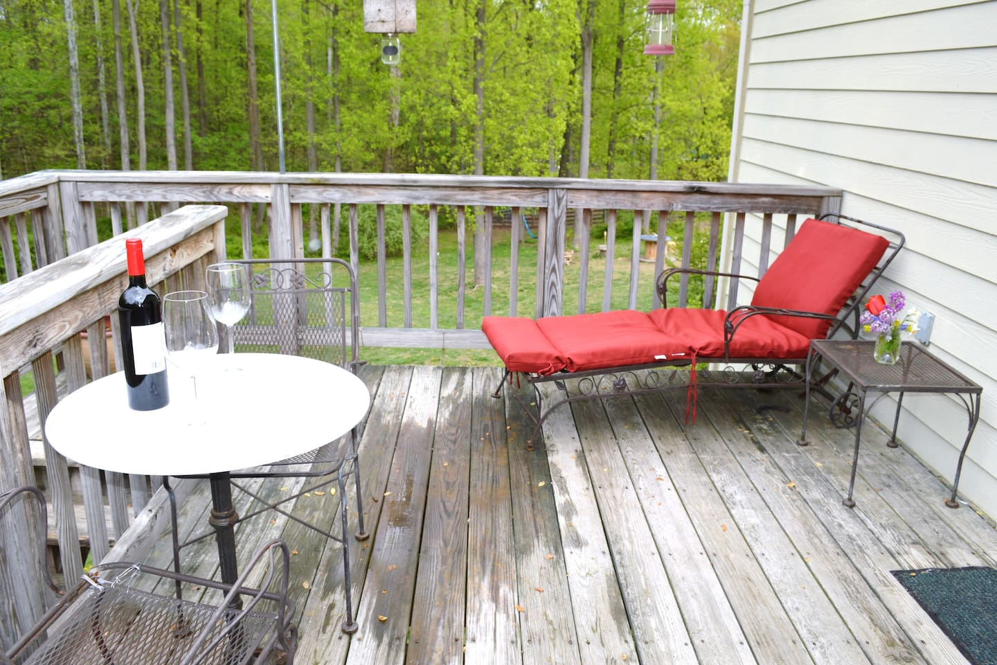 Relax on the private deck and enjoy the back yard views and sounds of nature.