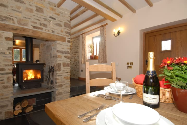 double sided log burner with 2 large baskets of logs provided - ideal for cosy gatherings