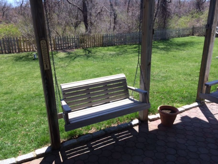 outdoor swing right outside for you to enjoy afternoon drinks on!
