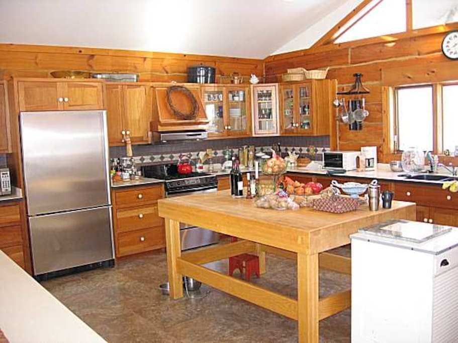 Spacious kitchen allows cooking for a crowd. Check out that cutting board!