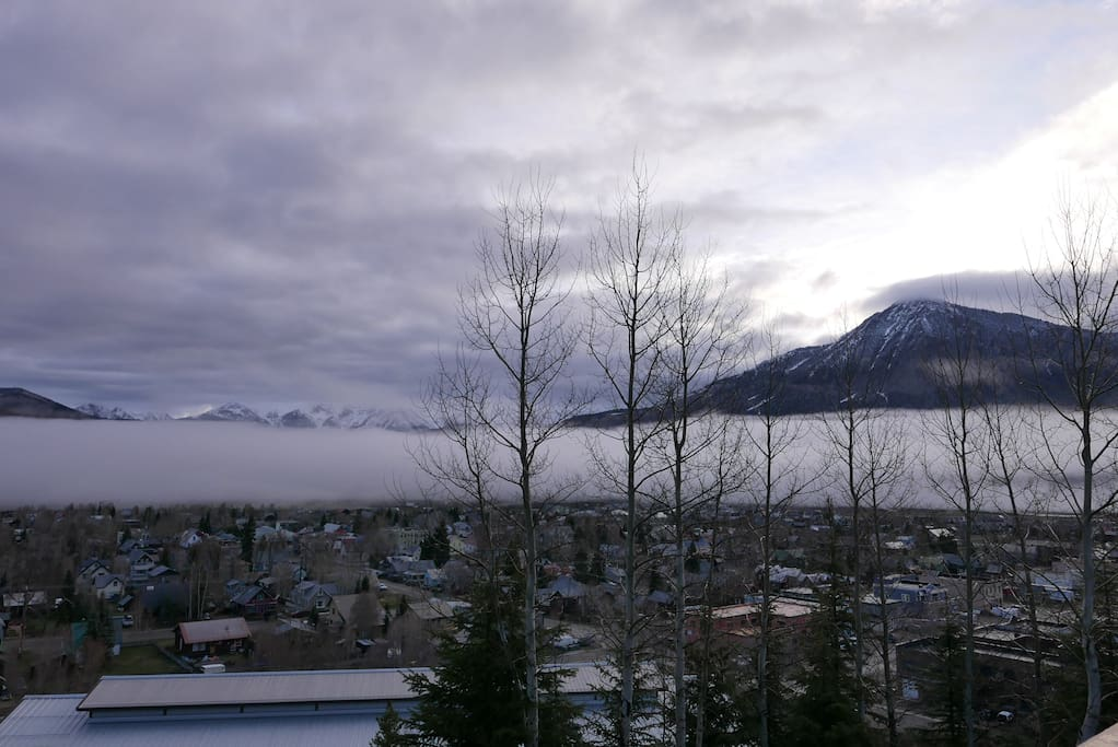 View from living room / deck: Fog sets in - nestled directly above town.  Mt. Butte rises above.