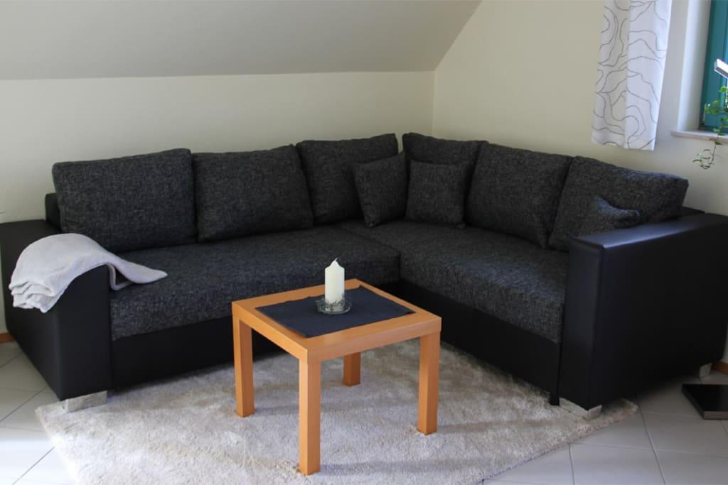 Gemütlicher Wohnbereich mit TV