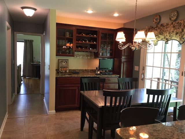Kitchen with table. Slider out to backyard/