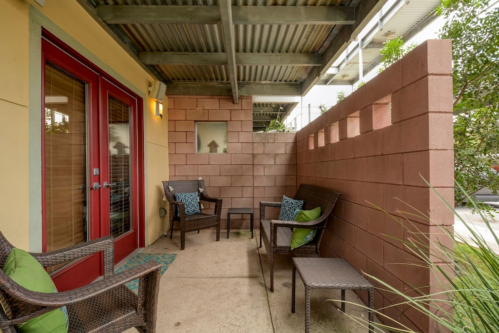 The front patio has seating for 4