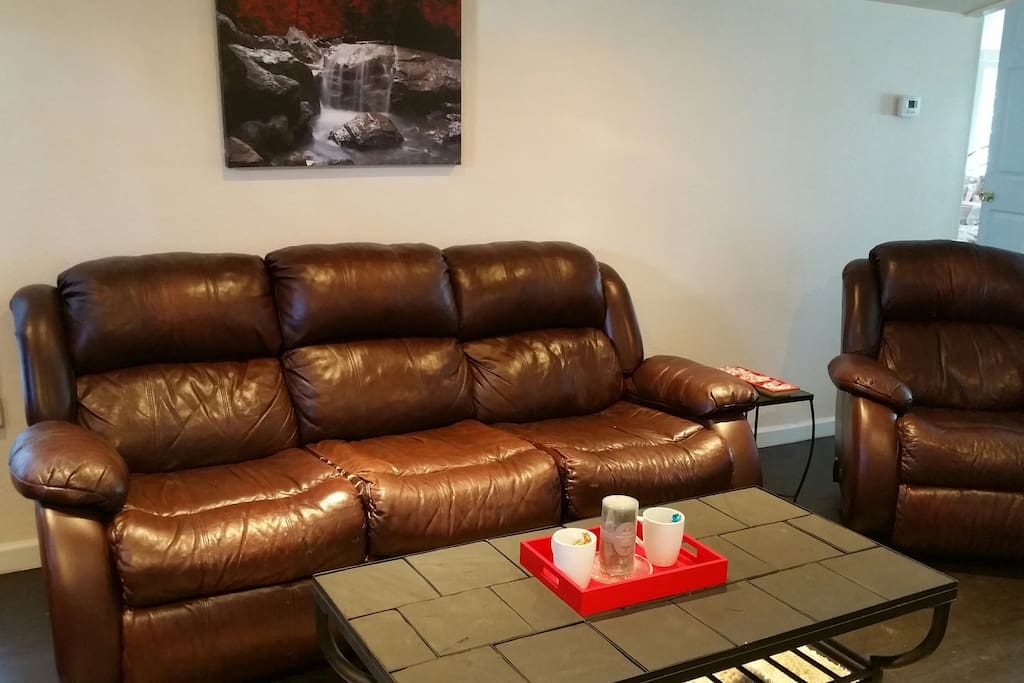 Leather furniture. Recliner lays flat if you like to stretch out.