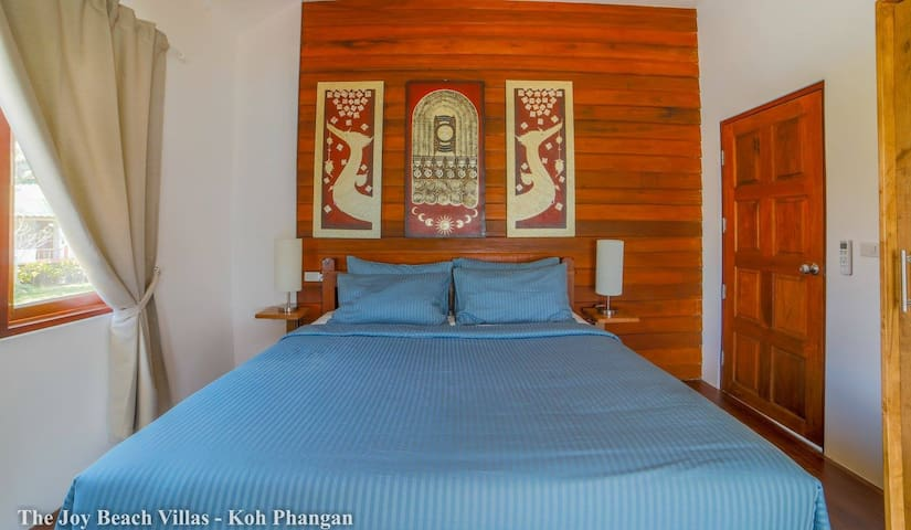 Comfortable bedroom with king-size bed and air-con