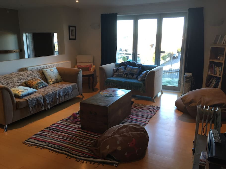 Sunny lounge with selection of books, toys, board games and DVDs for your use