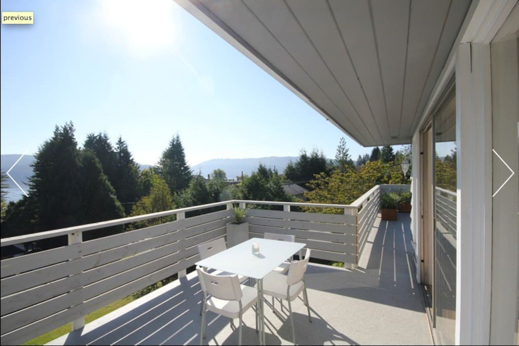 Back deck - where you can view mountains, treetops, an ocean glimpse