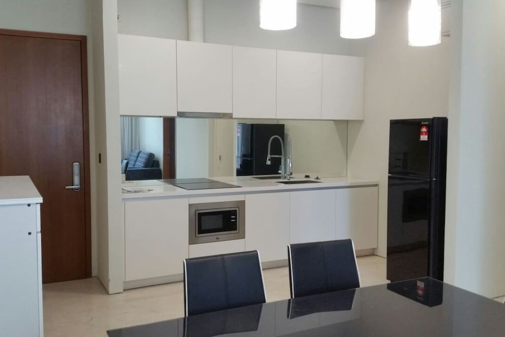 open kitchen for light cooking. fridge, oven, hob and hood provided.