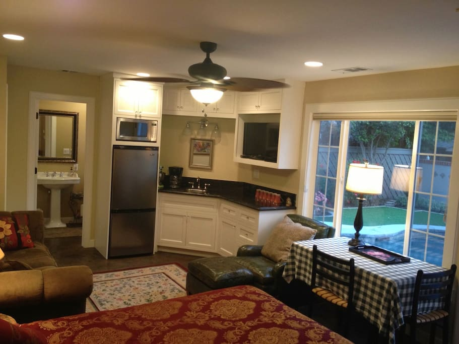 Mini kitchenette with refrigerator and microwave. Access to gas BBQ grill right outside. Beautiful pool view.