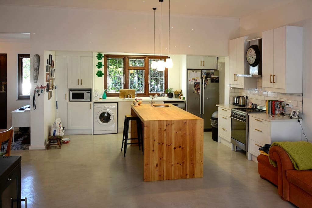 Large modern kitchen with double fridge and gas cooker
