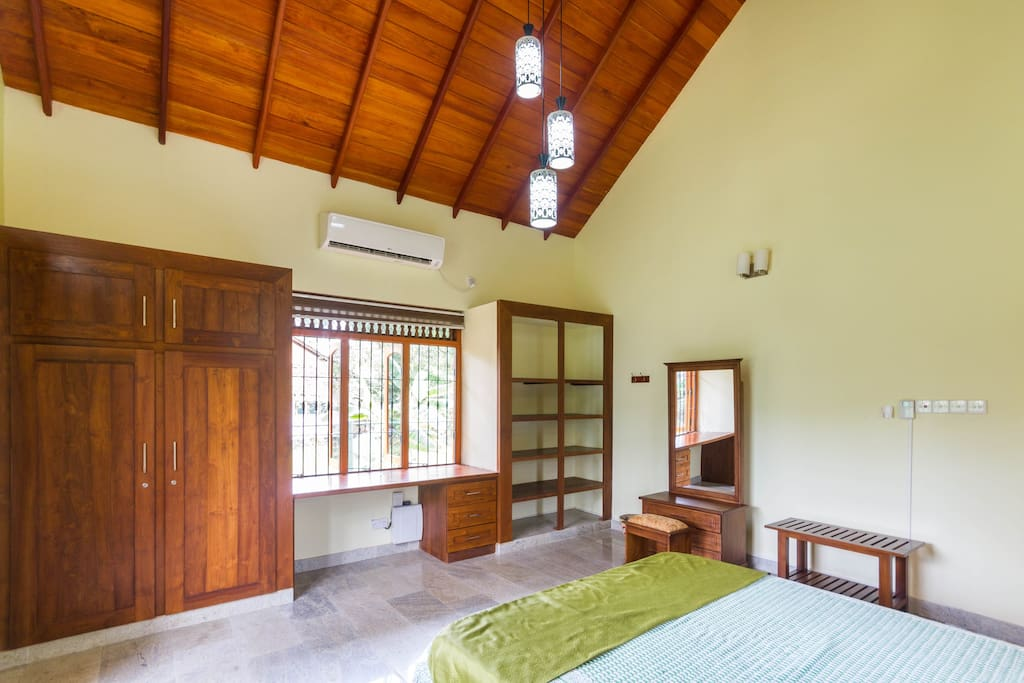 Air conditioned bedroom with plenty of storage