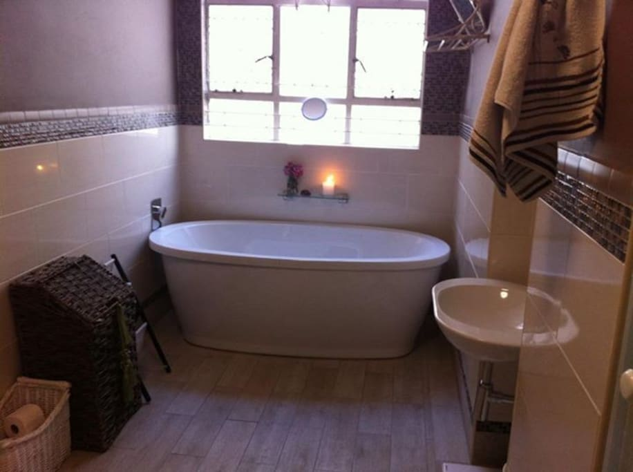 The shared bathroom which is located across the guest room. It has a shower & bath.
