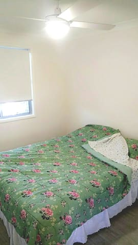 Master bedroom with queen size bed and fans in every room.