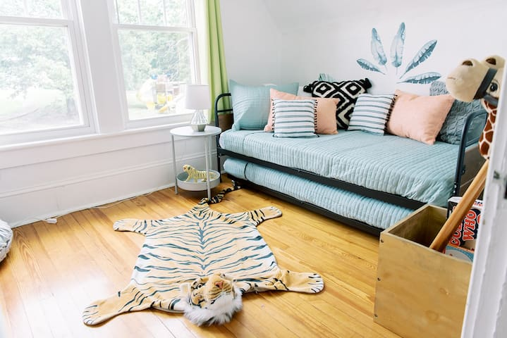 The kids room has a twin bed with a rollout trundle twin underneath and has been designed with your littles in mind.