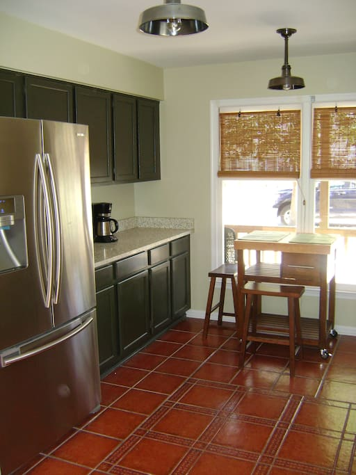 Fully updated kitchen with stainless steel appliances, concrete countertops