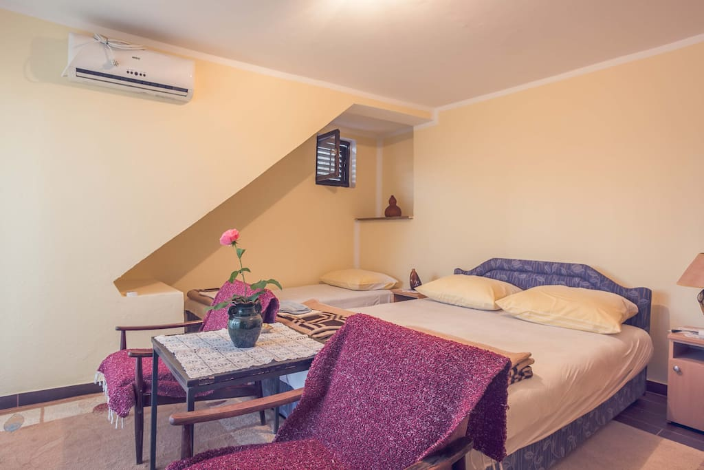 Bedroom with double bed for two persons and one single bed