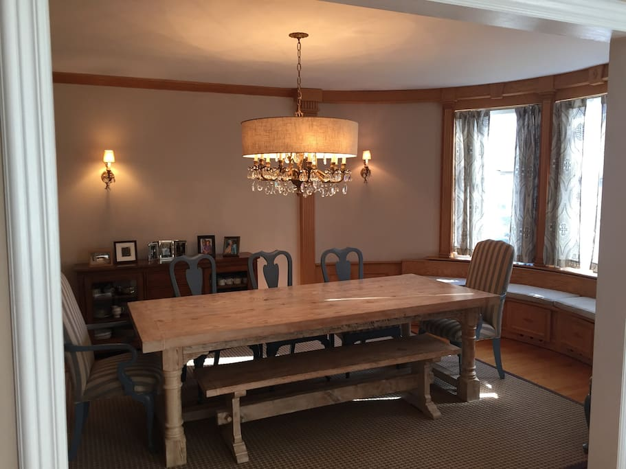 Huge dining room with bench for family dinners. Big dining room seats 8 and can expand to seat 12.